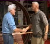 Photo of Clarence Perkins shaking hands with Jay Leno